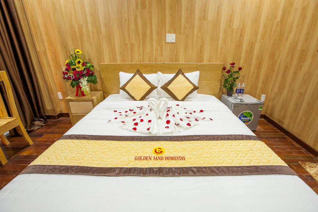 Deluxe tweepersoonskamer - Bed Golden Sand Homestay