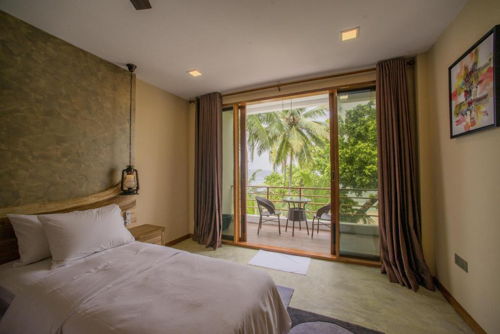 Deluxe Double Room with Balcony and Sea View - Guestroom Kiha Beach