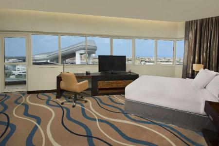 King Deluxe Room with Balcony - Guestroom DoubleTree by Hilton Hotel and Residences Dubai Al Barsha
