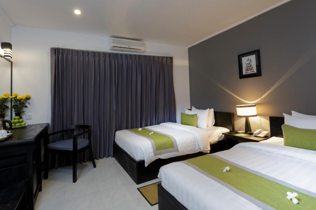 Deluxe Double or Twin Room - Bed The Cyclo Siem Reap Hotel