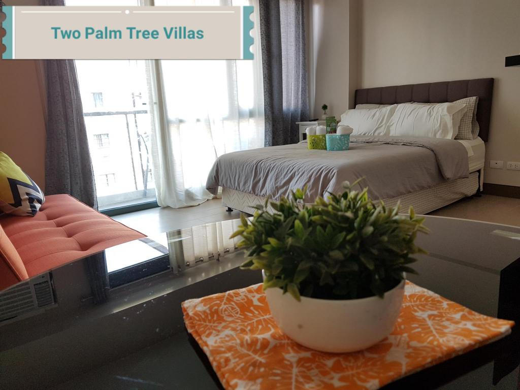 Airport Condo at Two Palm Tree Villas