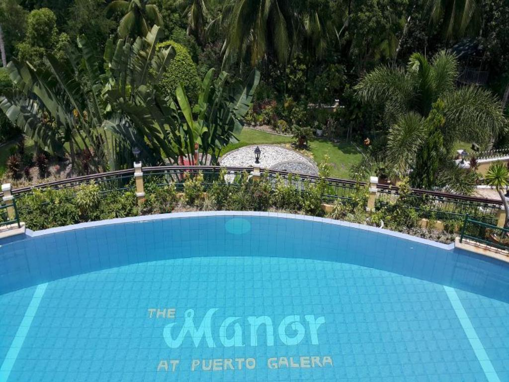 Swimming pool [outdoor] The Manor at Puerto Galera