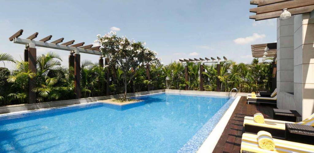 Lemon tree premier ulsoor lake bengaluru in bangalore room deals photos reviews for Bangalore resorts with swimming pool