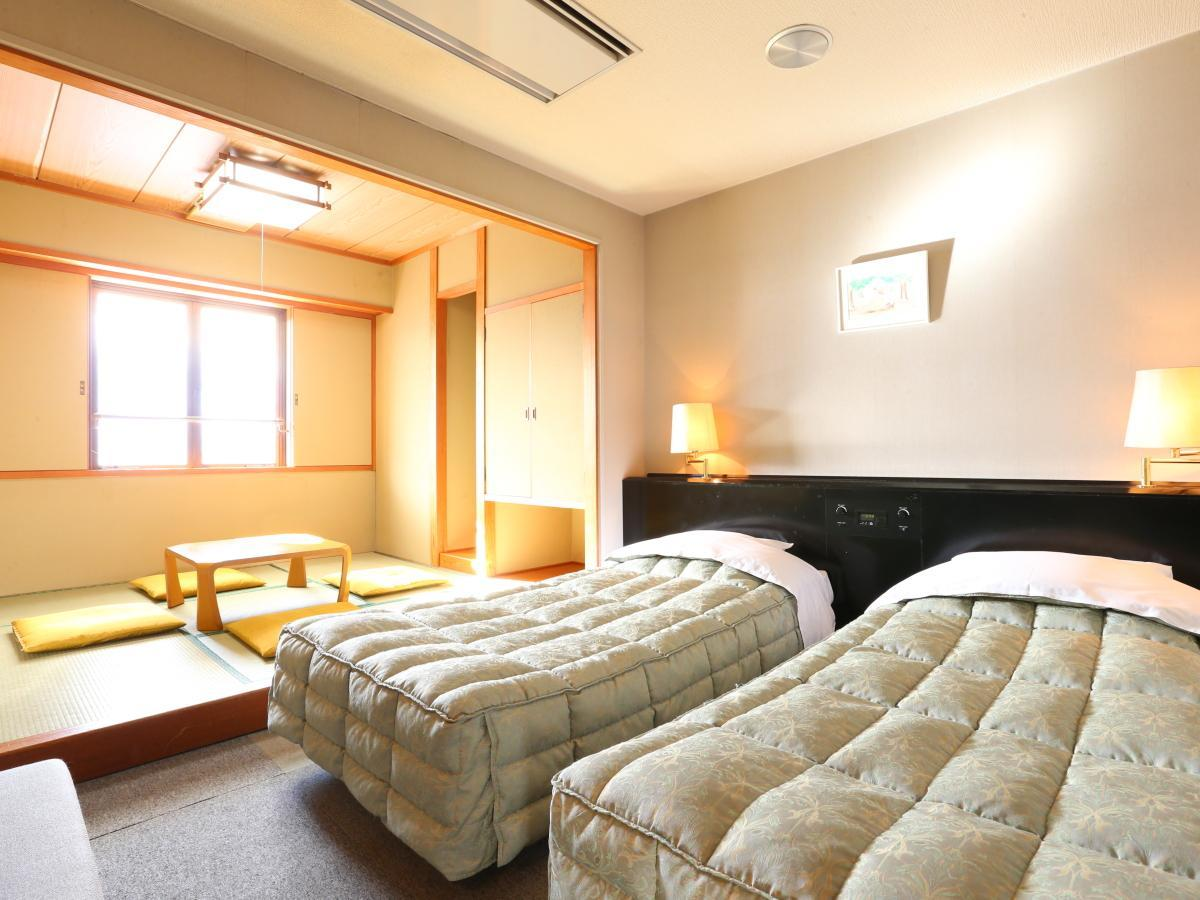 Pokoj Twin s prostorem na tatami (Twin Room with Tatami Area)
