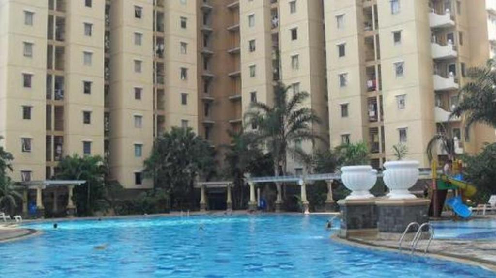 Swimming pool [outdoor] 1 BR Apartment Mediterania Gajah Mada - Room 15