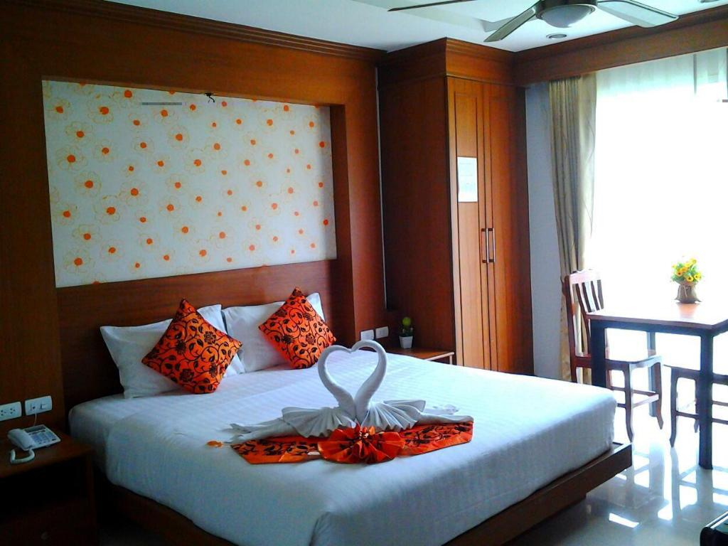 Standard Room with Kitchenette - Bed Green Harbor Hotel & Service Apartment