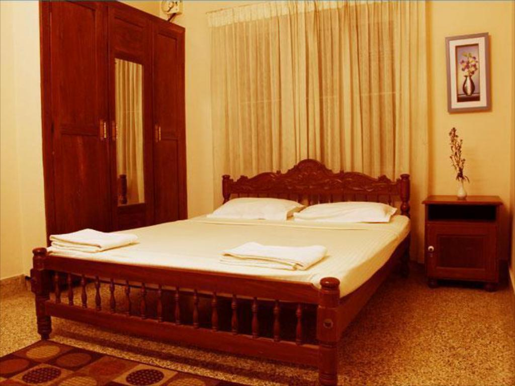 Deluxe Air Conditioning - Guestroom Fort Muziris Hotel