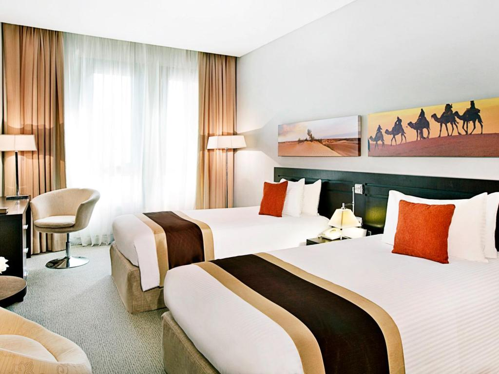 Quarto superior - Cama City Seasons Hotel Muscat