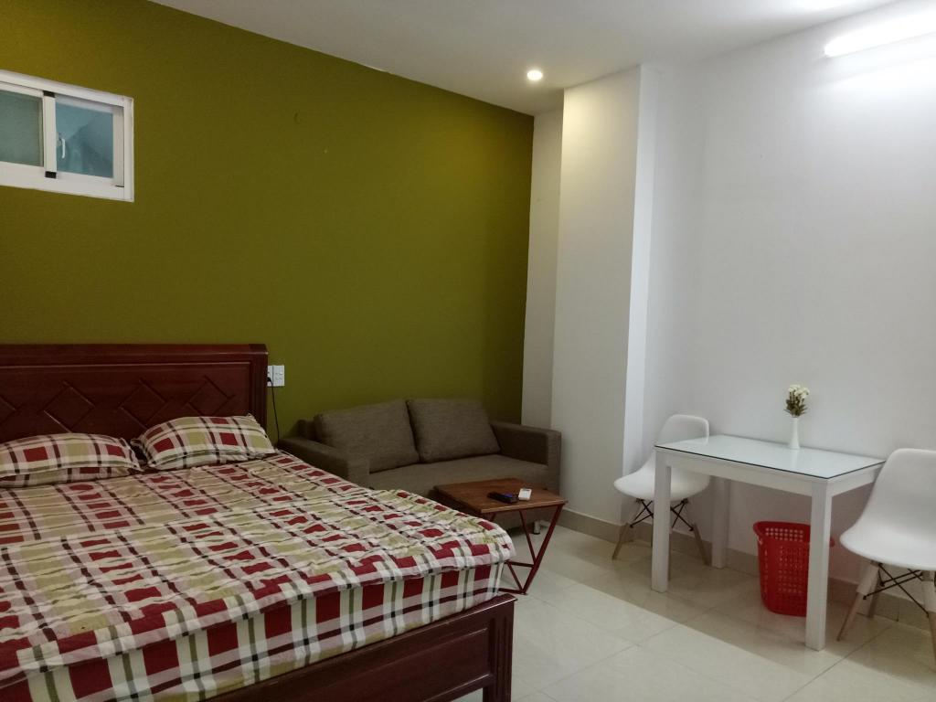 Tempat tidur Smiley Apartment 8- R01 Seviced studio with window 1