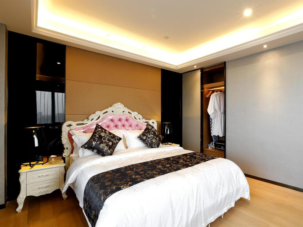 Deluxe Queen Suite - Bed Pengman Beijing Rd. A-mall Apartment