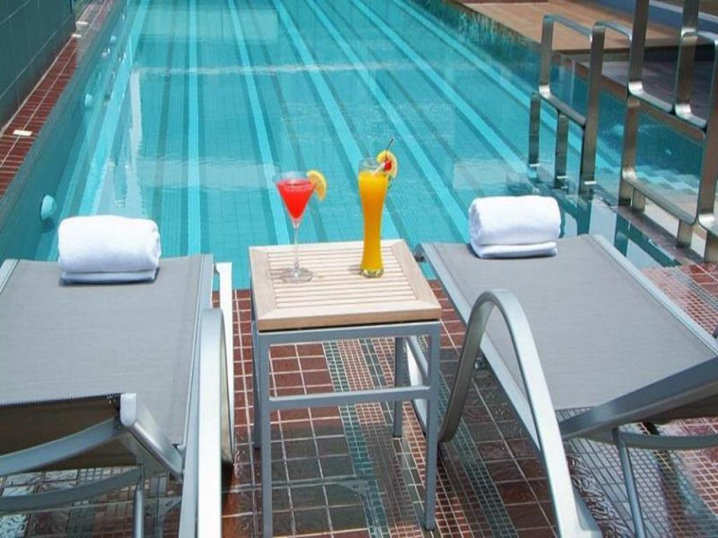 Swimming pool [outdoor] Amora NeoLuxe Suites