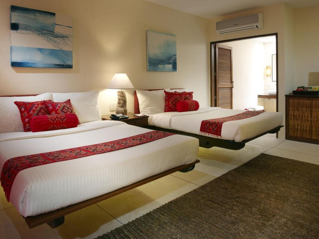 Premier Deluxe Room - Bed Bluewater Panglao Beach Resort