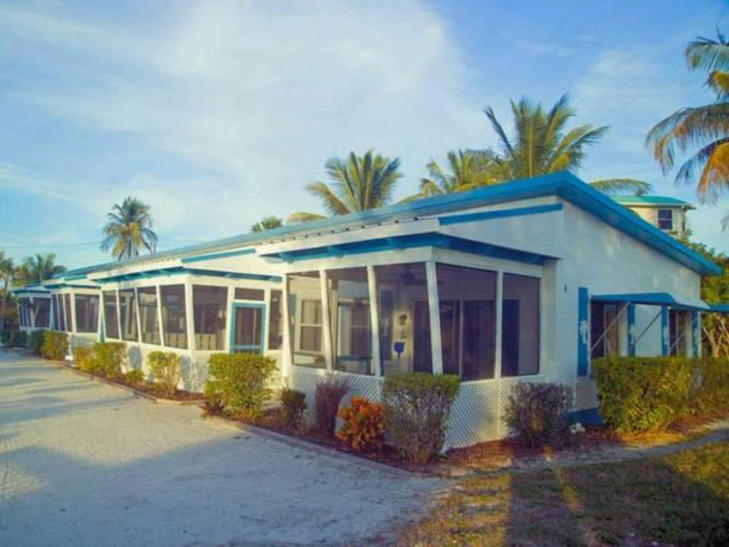 Das Tropical Winds Beachfront Motel And Cottages In
