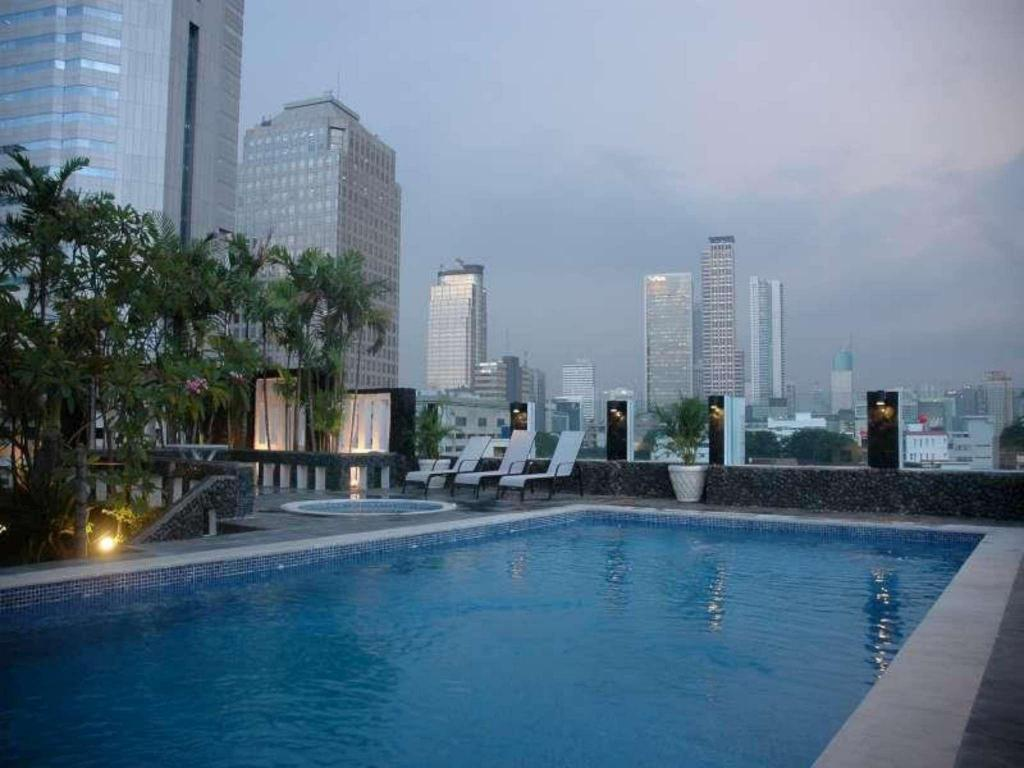 Swimming pool [outdoor] Takes Hotel Jakarta, a PHM Collection