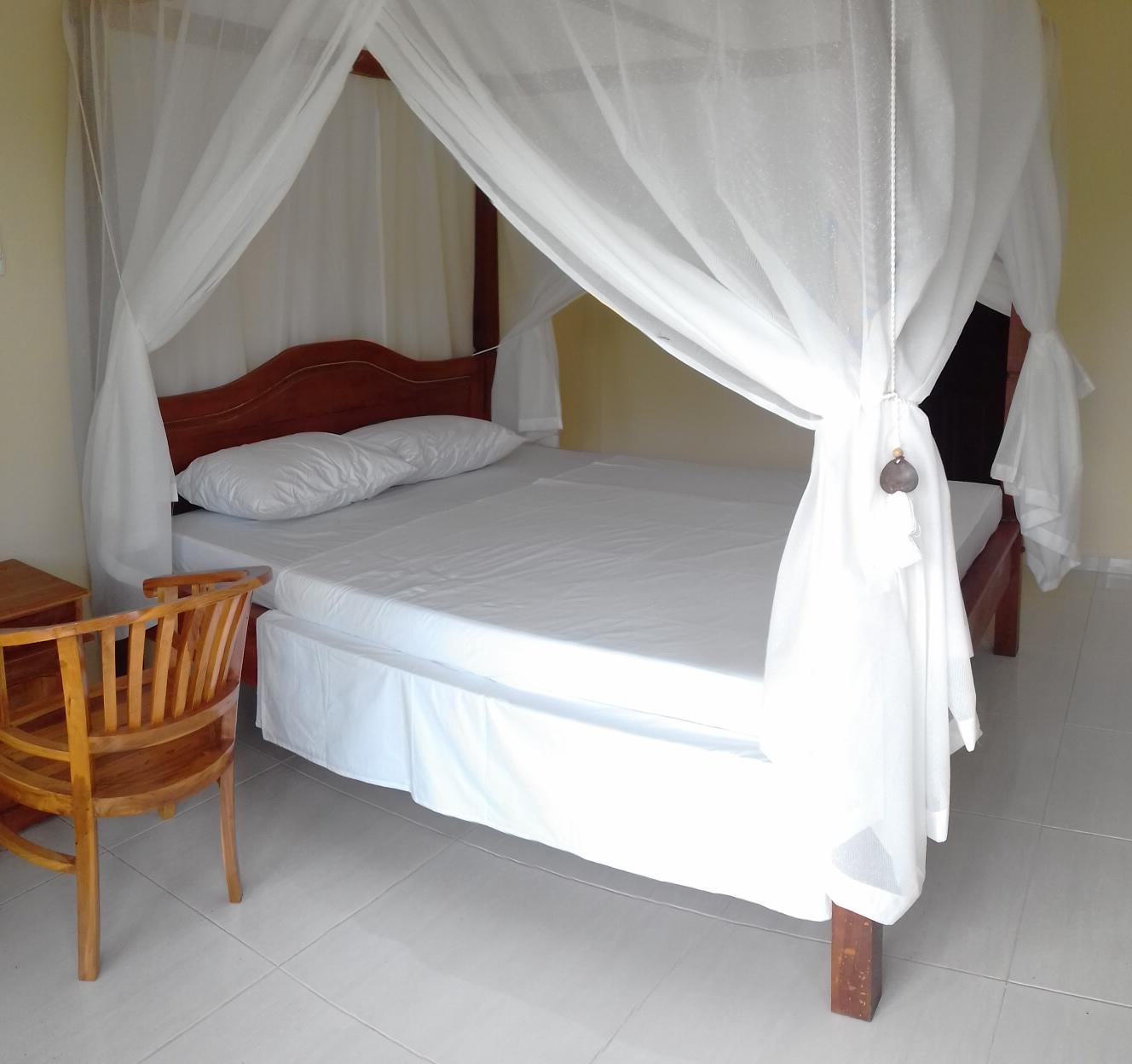 Kamar Standard Double dengan Pemandangan Taman (Standard Double Room with Garden View)