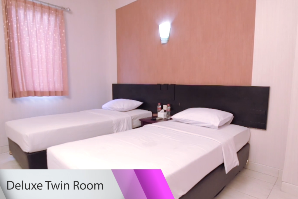 Deluxe Twin Room - Bed Malioboro Palace Hotel