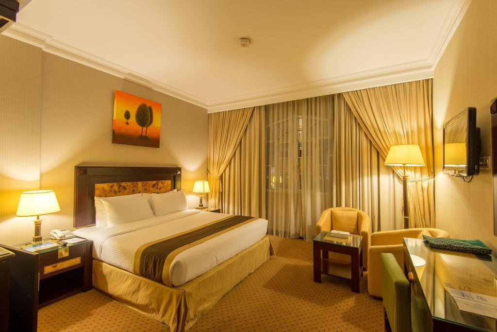 Quarto superior - Quarto Waves International Hotel