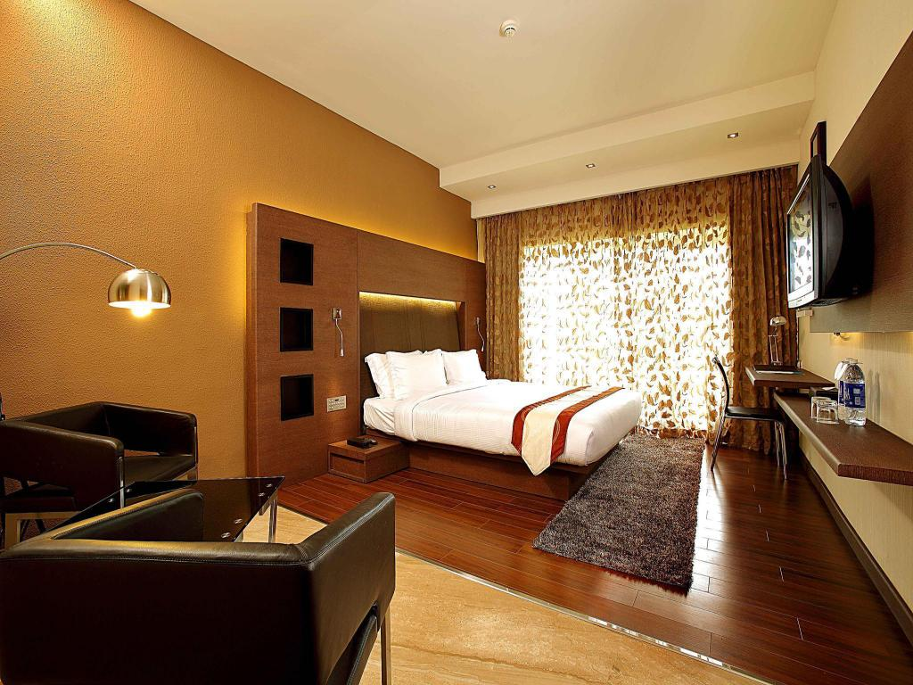 Deluxe King - Cama Flora Airport Hotel