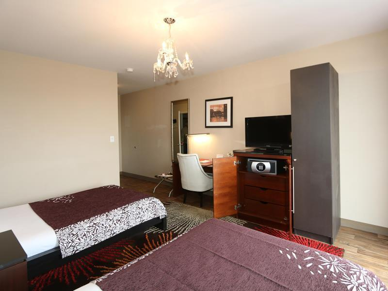 Superior, One Queen and One Full Bed with Balcony