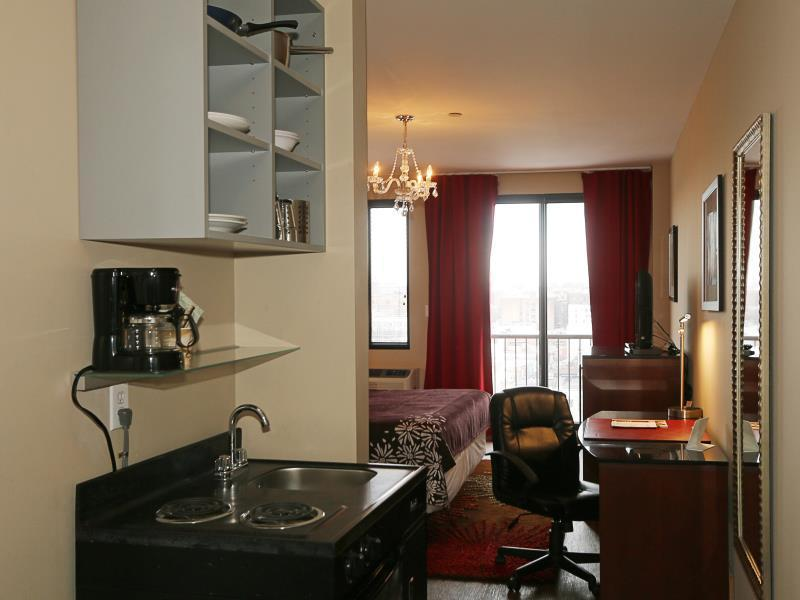 Executive Two Double Beds with Balcony and Kitchenette
