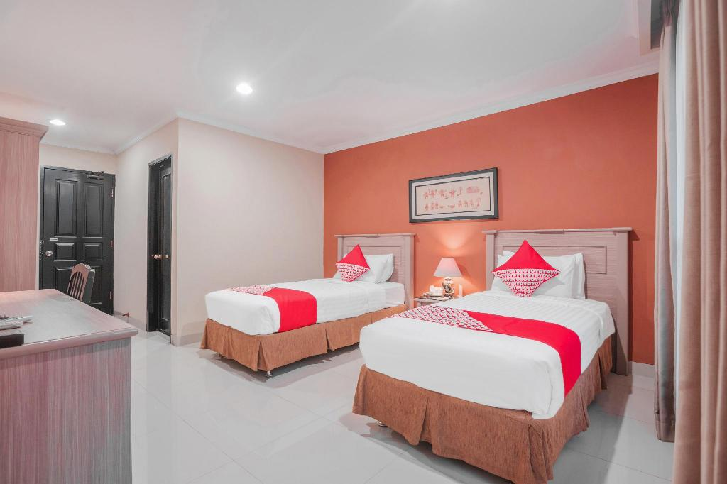 Standard Twin Room - Bed Capital O 534 Sriwijaya Hotel