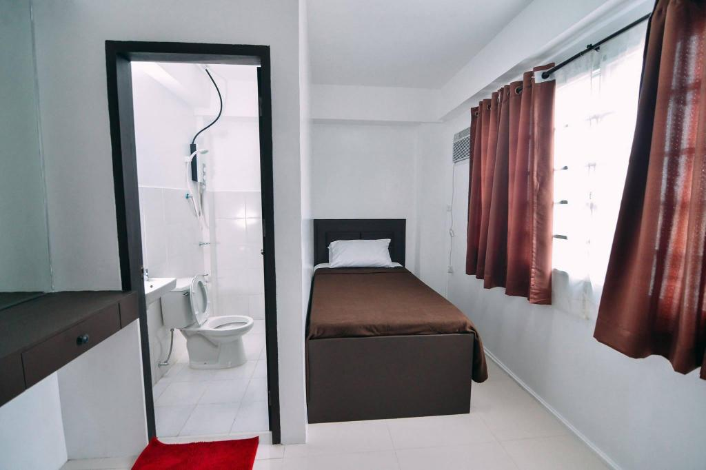 Single - Guestroom The Strand Suites and Dormitel