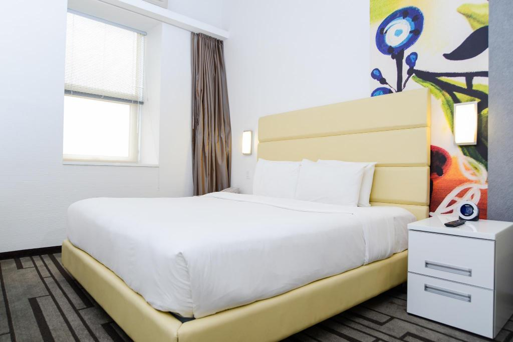 King Guestroom - Bed Hotel De Point