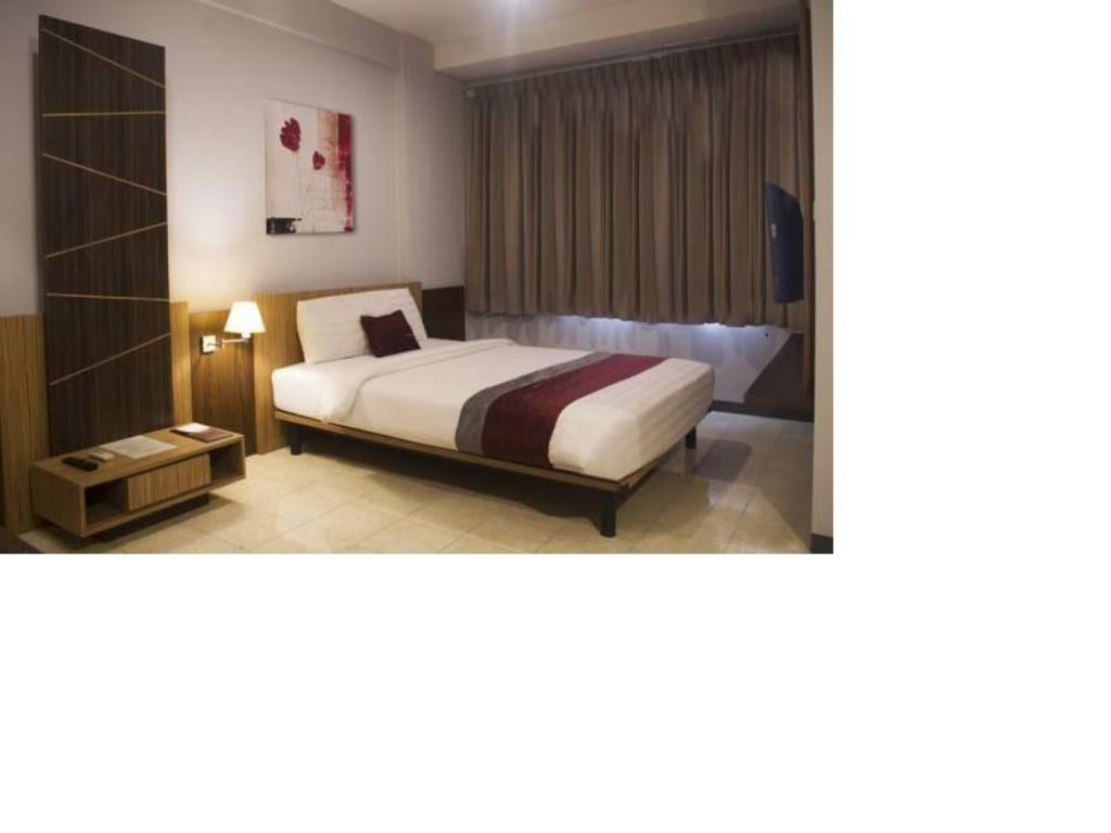 Deluxe Double - Kamar tidur Simply Valore Hotel