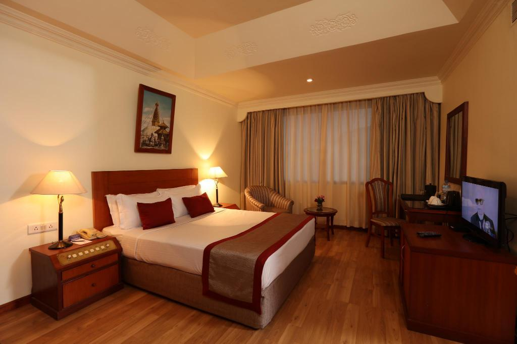 Deluxe Rooms - Bed Royal Singi Hotel