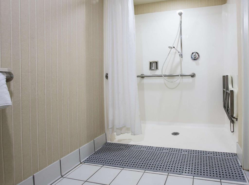 1 King Mobility Hearing Accessible Roll In Shower - Guestroom Hilton Concord Hotel