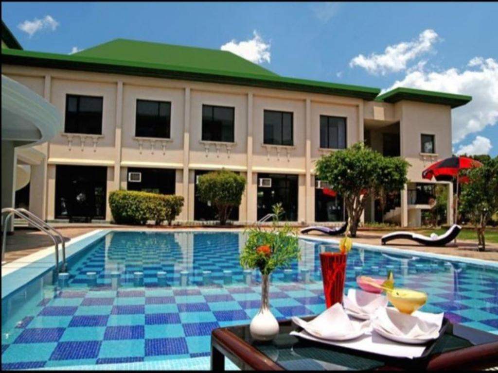 Swimming pool Country Inn Kosi