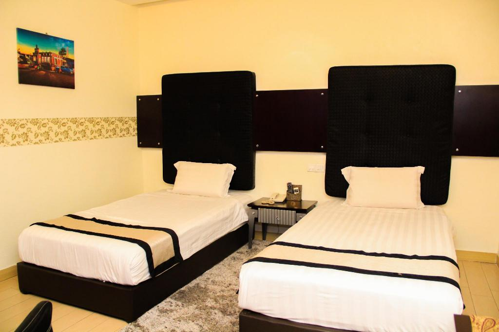 Superior Twin Room without Window - Bedroom Shervinton Executive Boutique Hotel