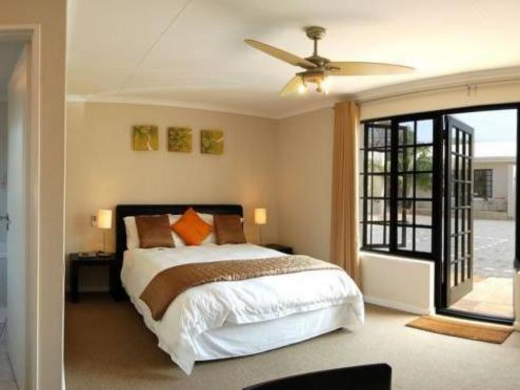 Suite with Garden View - Guestroom Palm Beach Guesthouse