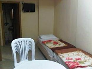 Quarto triplo (Triple Room)
