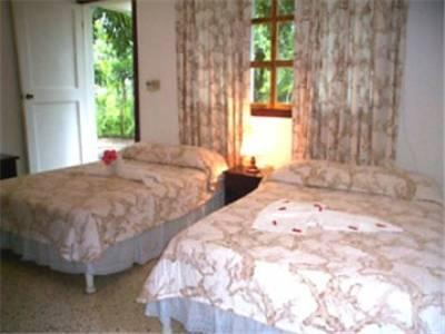 Double Room with Two Double Beds and Garden View