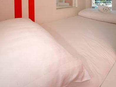 4 床混合宿舍房的 1 張單人床 (Single Bed in 4-Bed Mixed Dormitory Room)