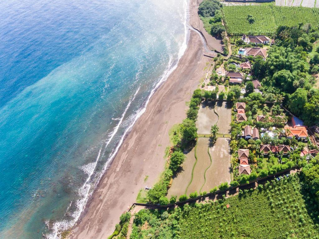 Best Price on Ganesha Bali Coral Reef Villas in Bali + Reviews!