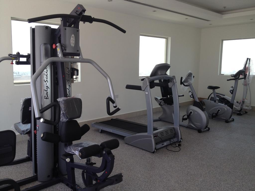 Fitness center Loumage Hotel & Suites