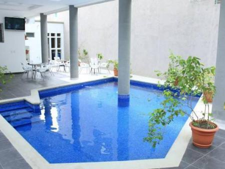 Swimming pool Hotel Casa del Arbol Galerias