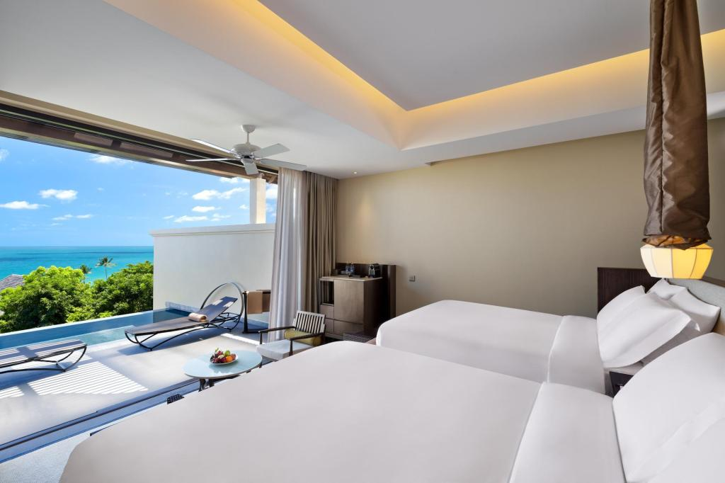 Premium Ocean Pool, 1 Bedroom Suite, 2 Queen, Sofa bed - Bed