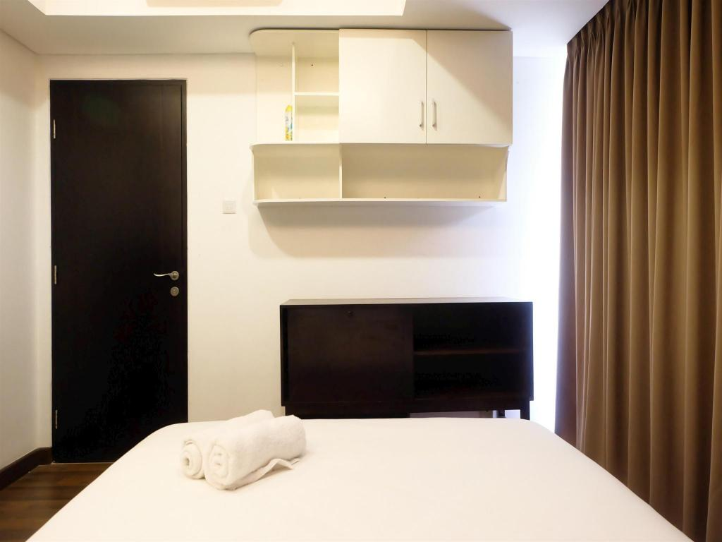 Interior view 1BR Exclusive Royale Springhill Apt By Travelio