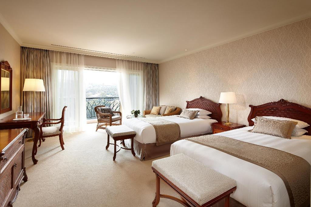 Deluxe Garden View Twin Room - Bed Lotte Hotel Jeju