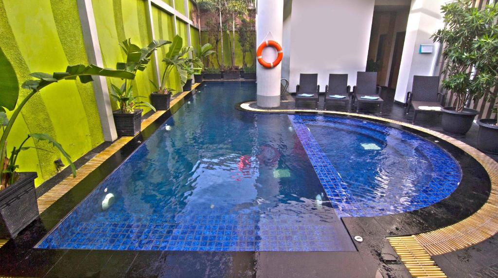 Swimming pool [outdoor] Grand Tjokro Yogyakarta Hotel