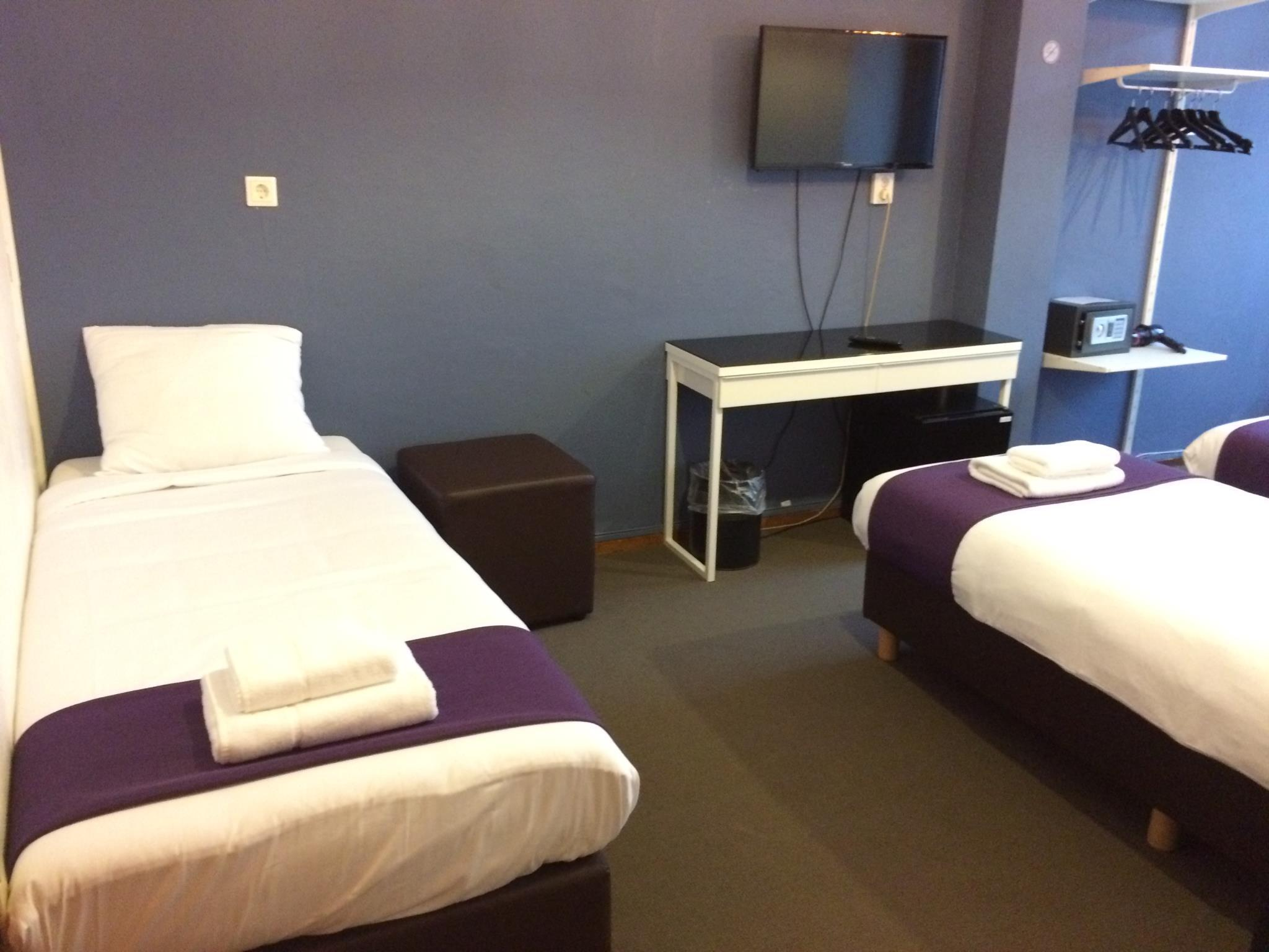 Triple - 2 Single Beds + 1 Extra Bed