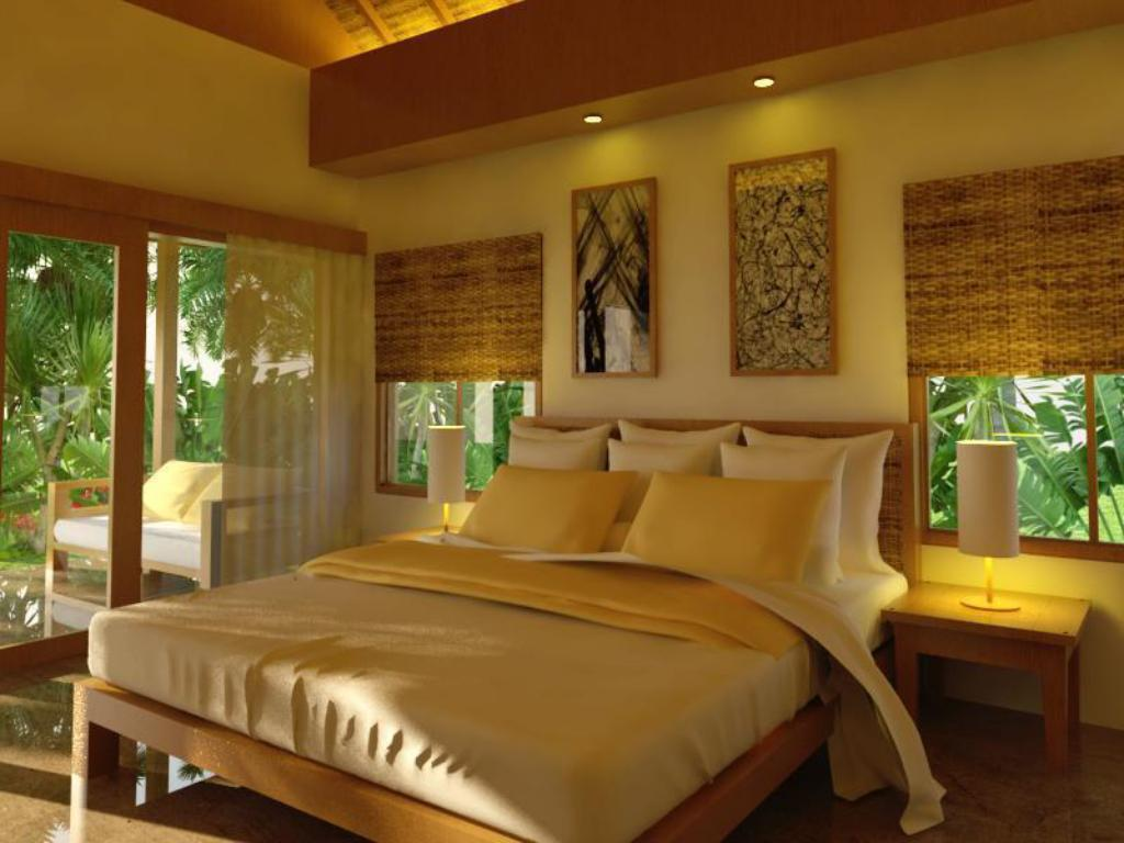 Deluxe Bungalow - Bed The Liliput Resort and Spa Pemuteran