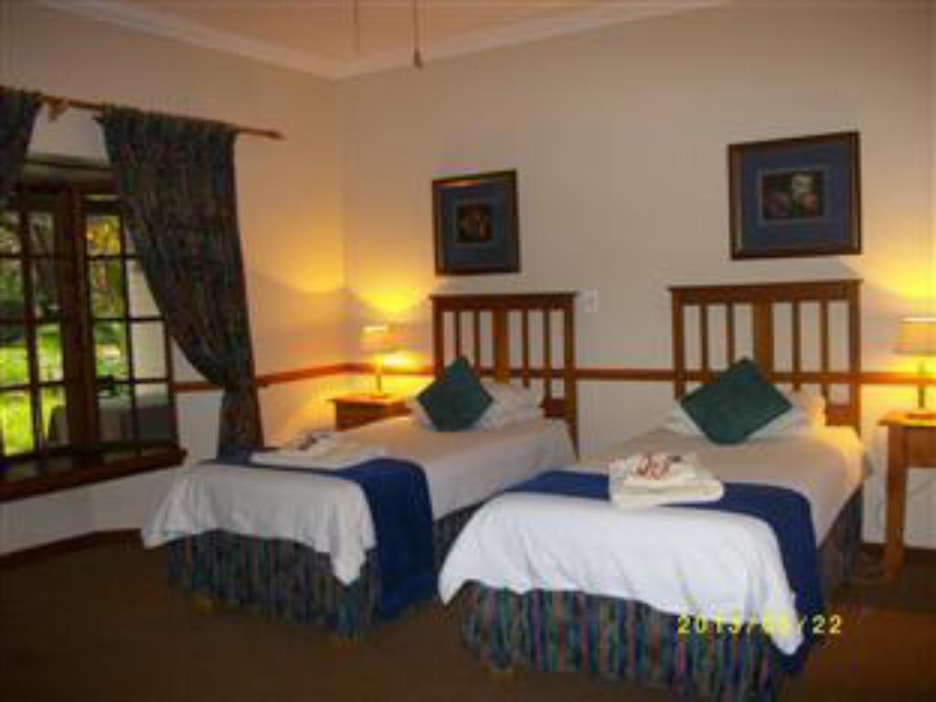 Deluxe Room - Bed PUMULANI LODGE