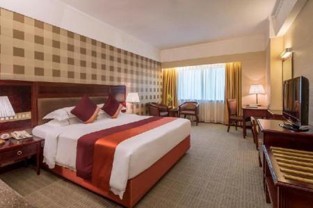 Deluxe King Room - Bed Asia International Hotel