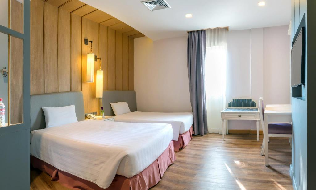 Grand Deluxe Twin Room - Bed Royal Rattanakosin Hotel