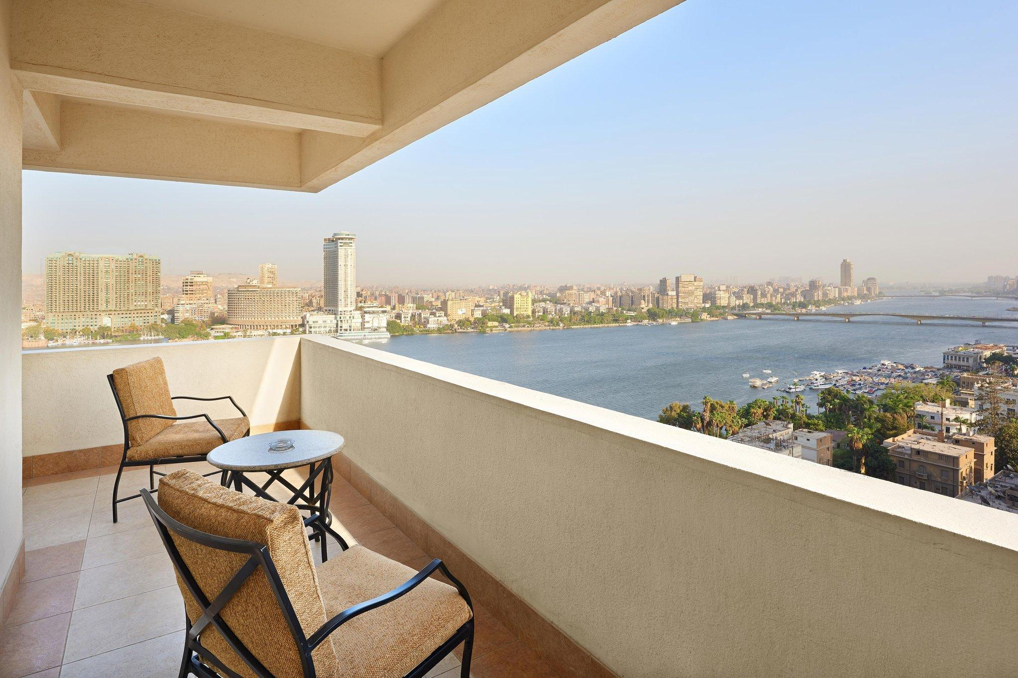 Premium, Guest room, 1 King, Partial Nile view, Balcony