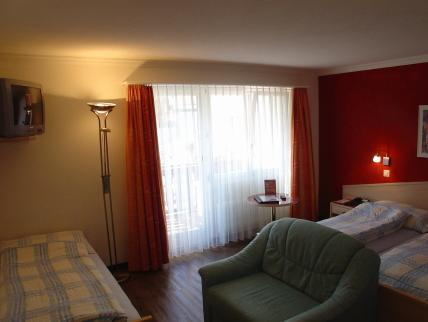 Trippelrom med balkong (Triple Room with Balcony)